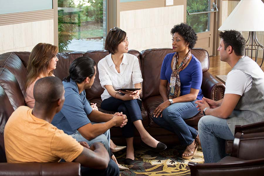 people meeting together on a comfy couch