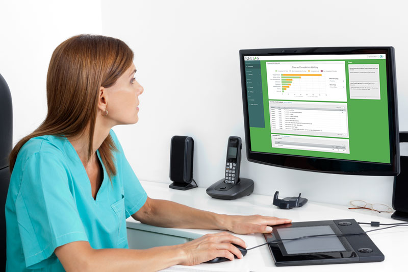 Female nurse working on a computer