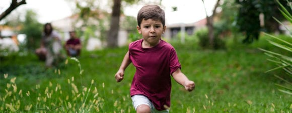 boy running away from parents