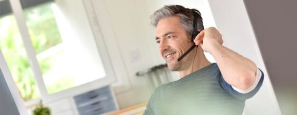 man talking on phone with headset