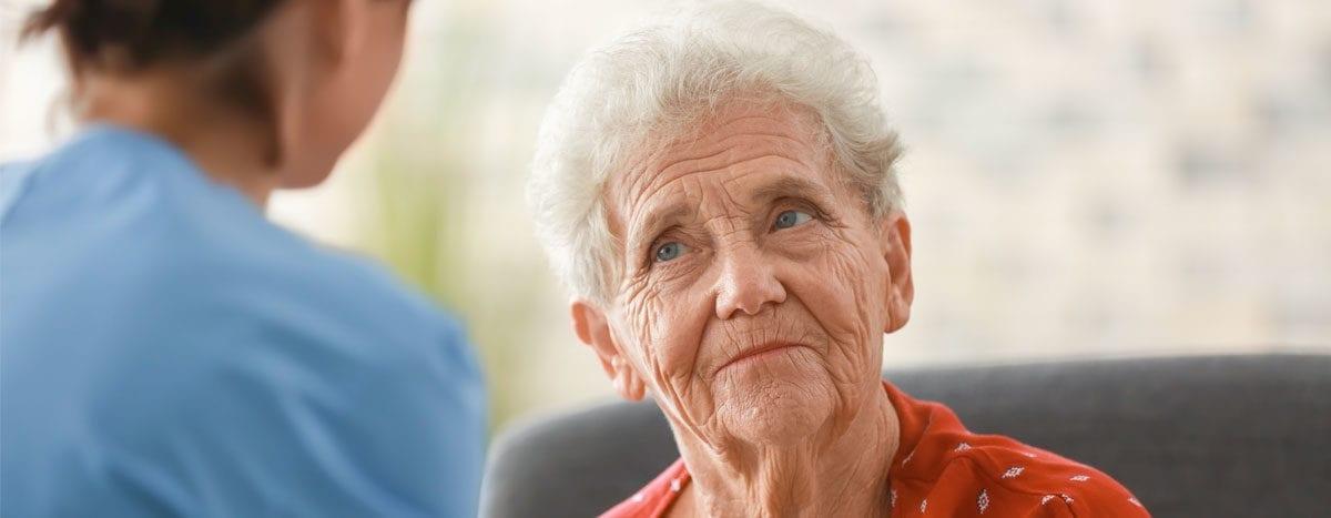 older woman with caretaker